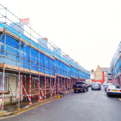 Scaffolding spanning length of the street